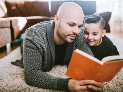 Father reading to his son in a different language