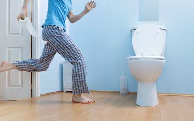Man runs to bathroom toilet