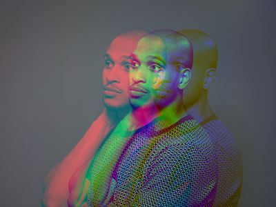 A multiple exposure portrait of a man looking to the left of the screen using a color spectrum.
