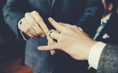 two men exchanging wedding rings