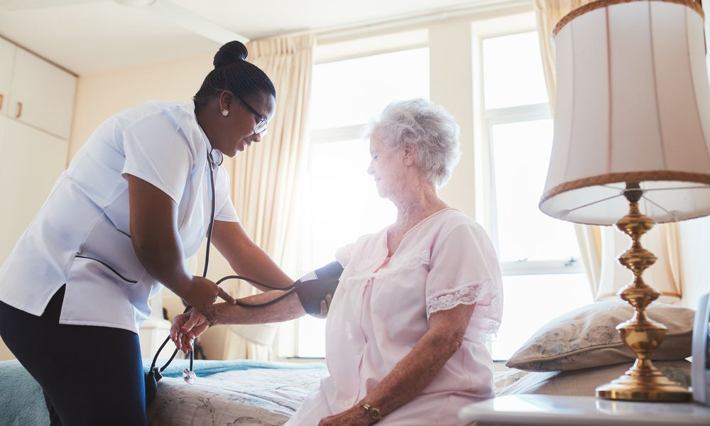 home health worker taking care of elderly patient