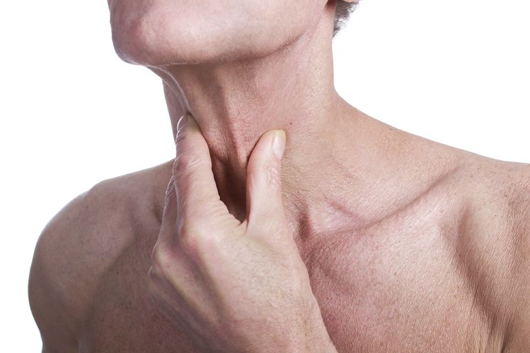 man experiencing tachypnea and holding his throat