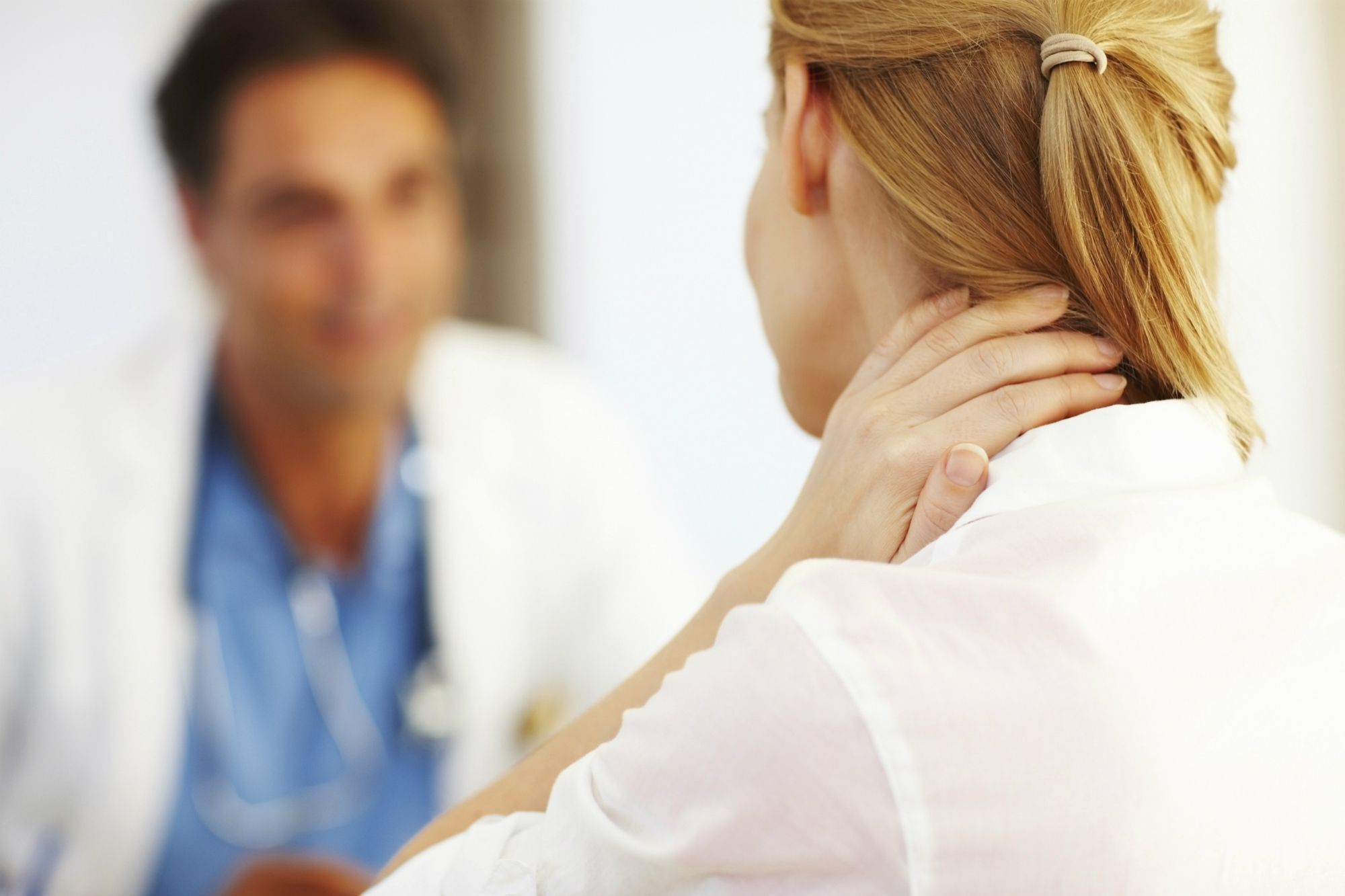 Patient discussing neck problems with doctor