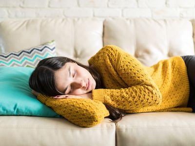 Woman Sleeping Comfortably in Living Room