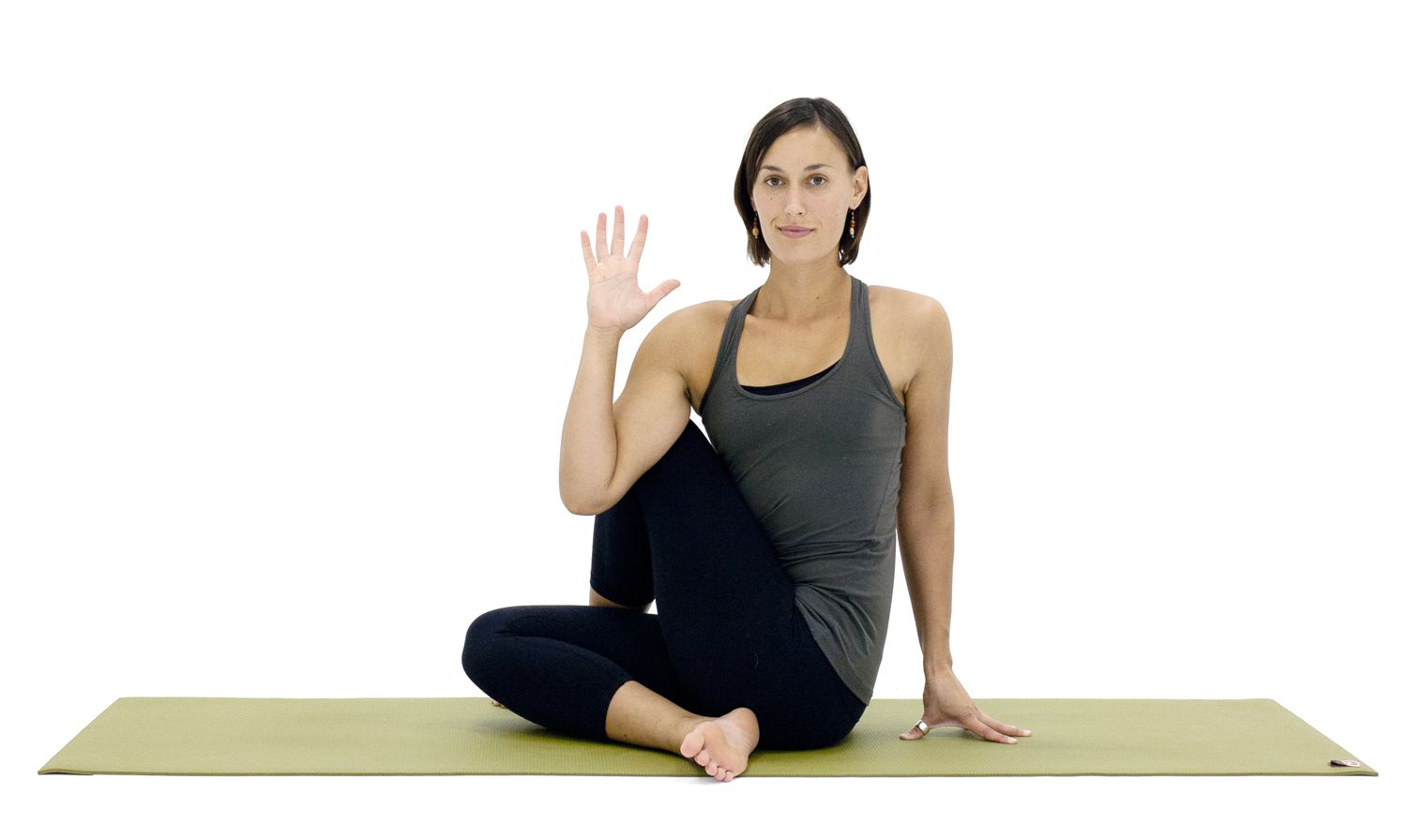 woman demonstrating Half Lord of the Fishes Pose
