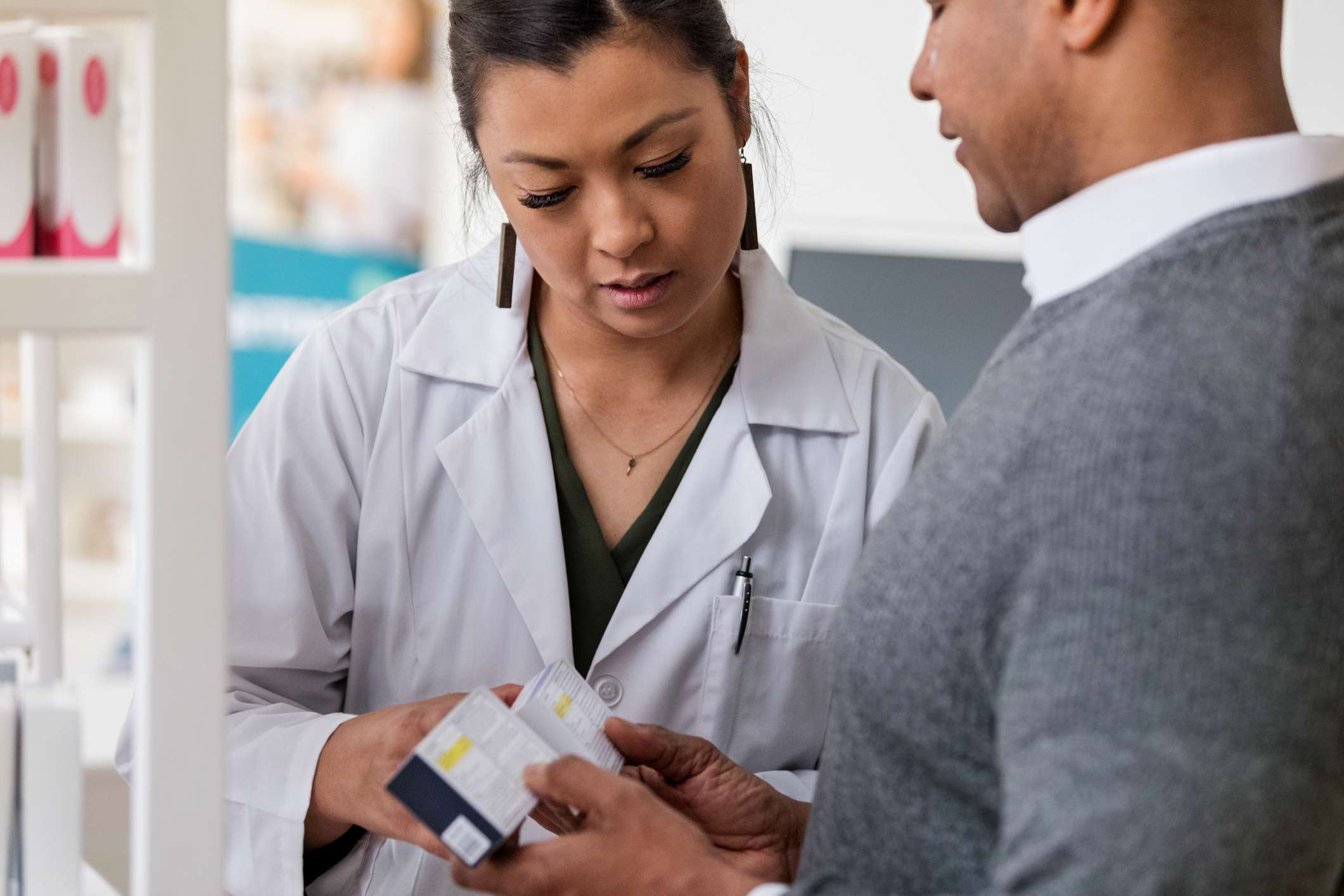 Pharmacist and client discuss medications