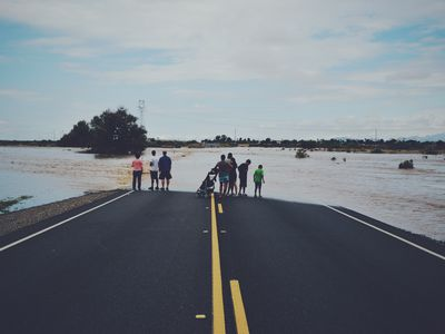 People on a Flooded Highway