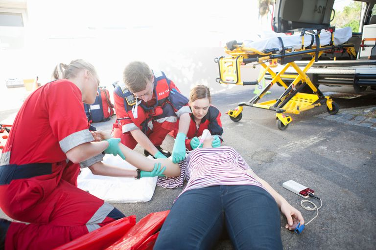 paramedics treating patient