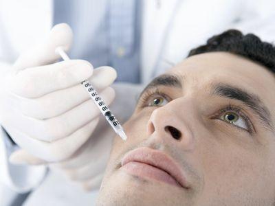 man receiving facial injection