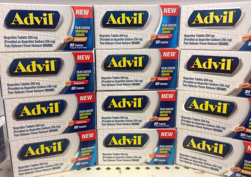 Boxes of Advil stacked on a shelf