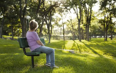 Woman in park, grieving