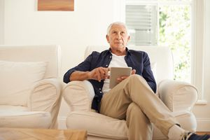 Older man in arm chair