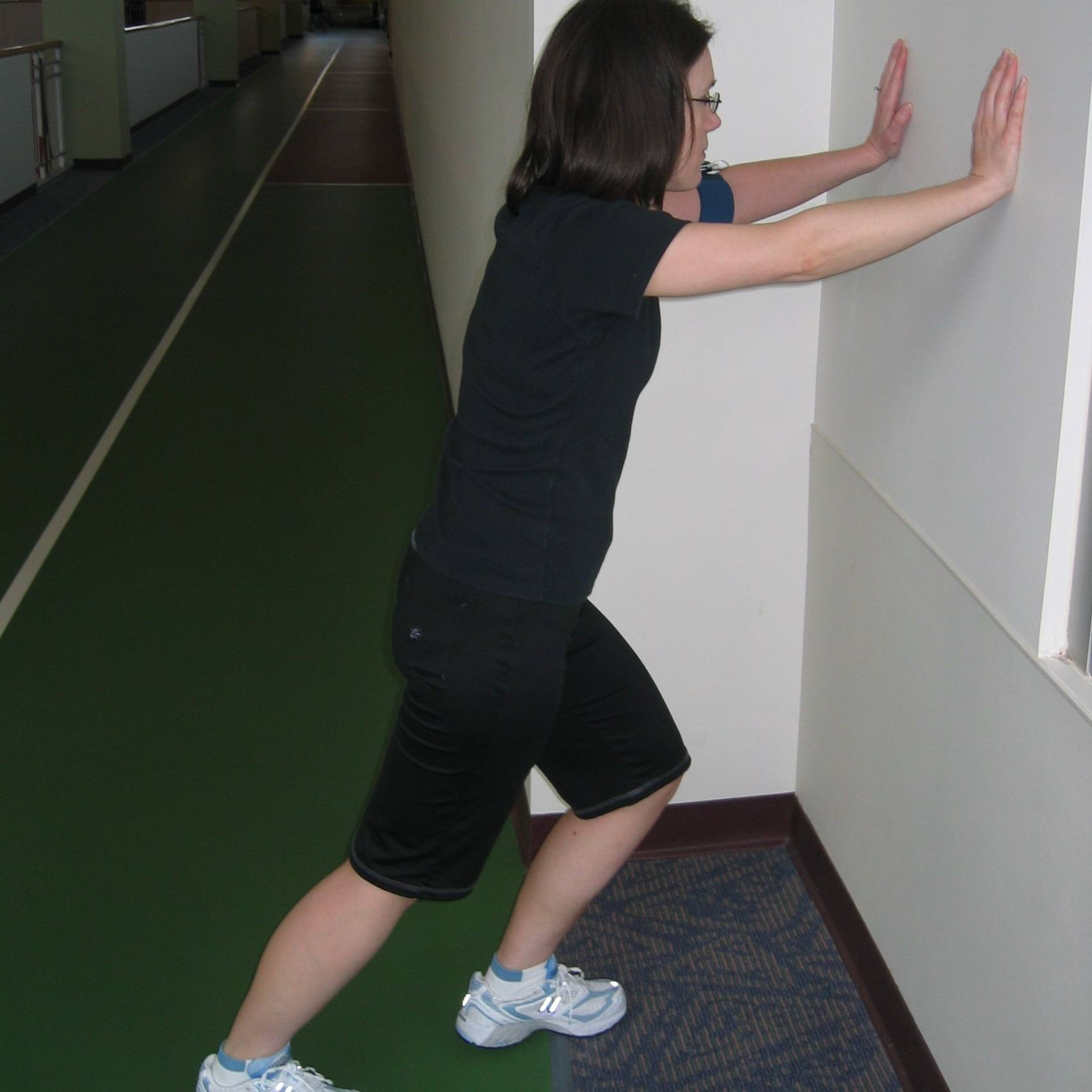 Bent knee wall stretch for the soleus muscle.