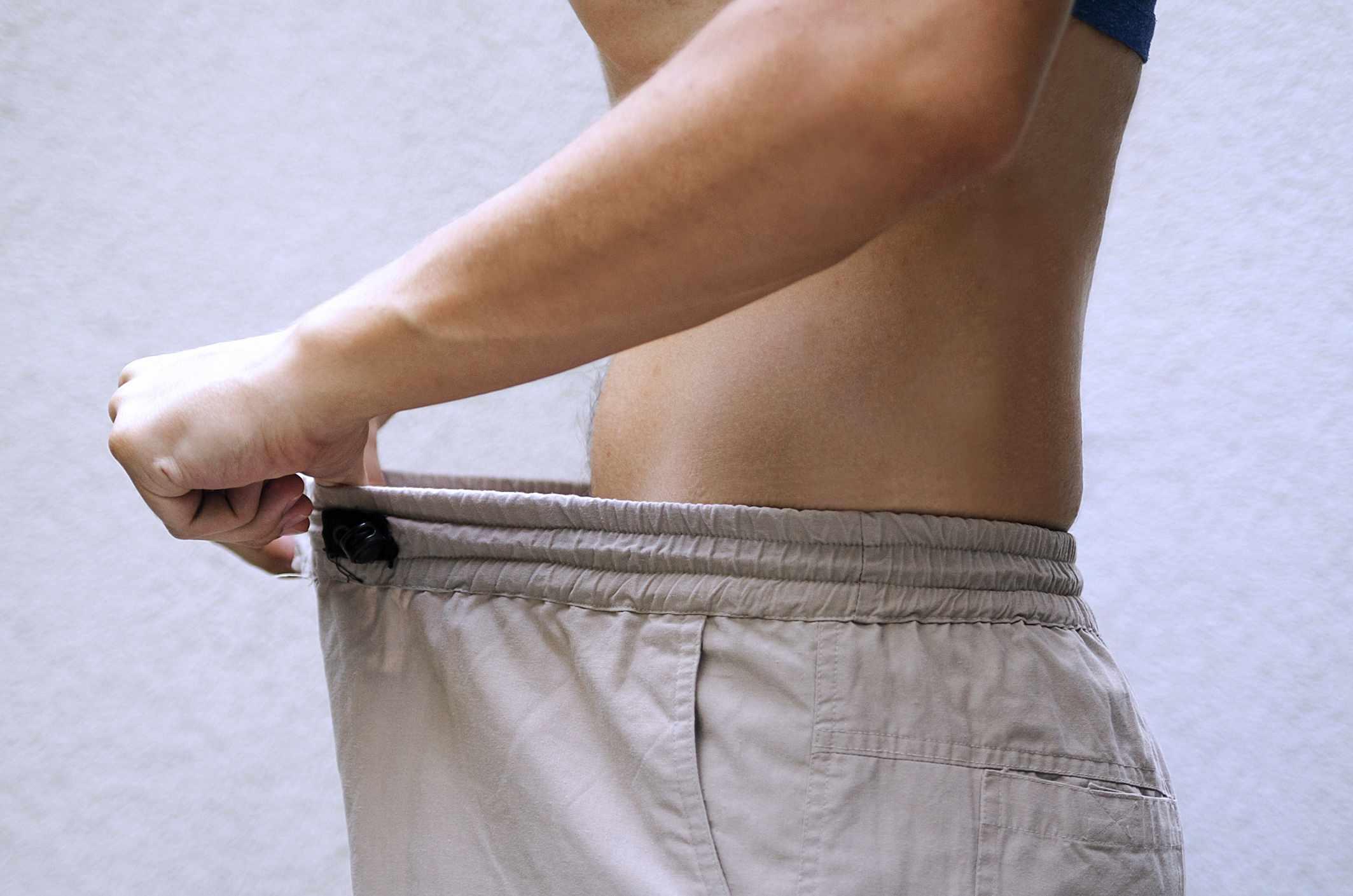 Man investigating down his pants