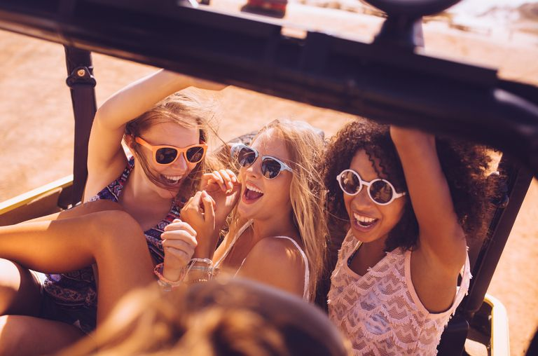 High angle shot of a mixed racial group of girl friends shouting excitedly to be going on a road trip vacation