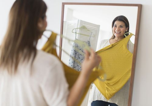 Woman trying on plus-size clothes