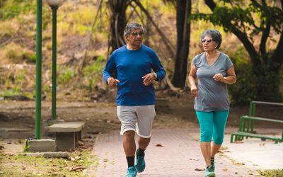 Older couple jogging in a park