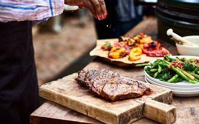 woman seasoning red meat