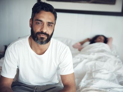man sitting on the edge of the bed