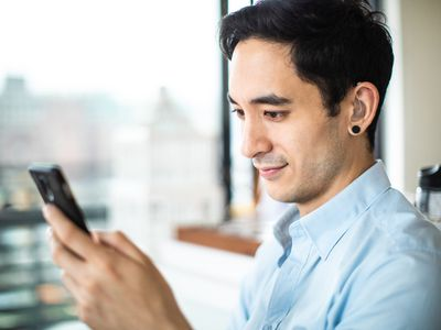 Hearing impaired man reading e-mail on phone