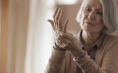 Senior woman with rheumatoid arthritis hand pain