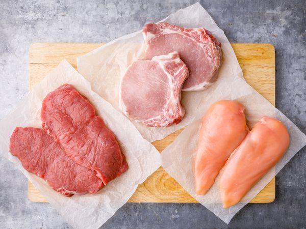 Raw steak, pork chops, and chicken