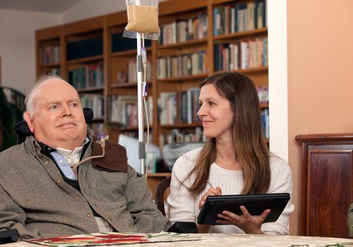 Home Healthcare Nurse and Patient Exchange Smiles