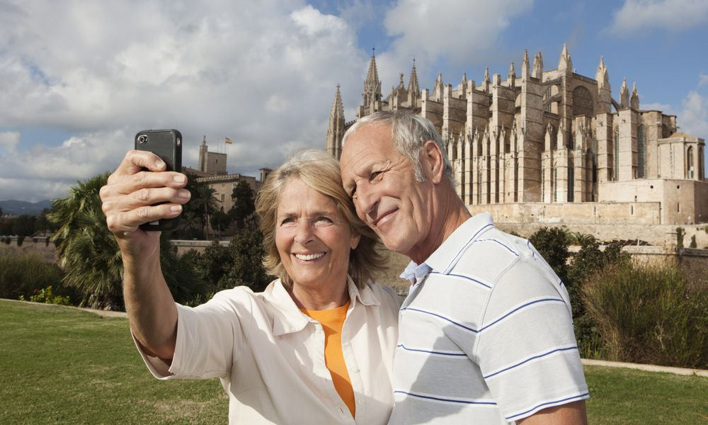 An older couple sightseeing abroad