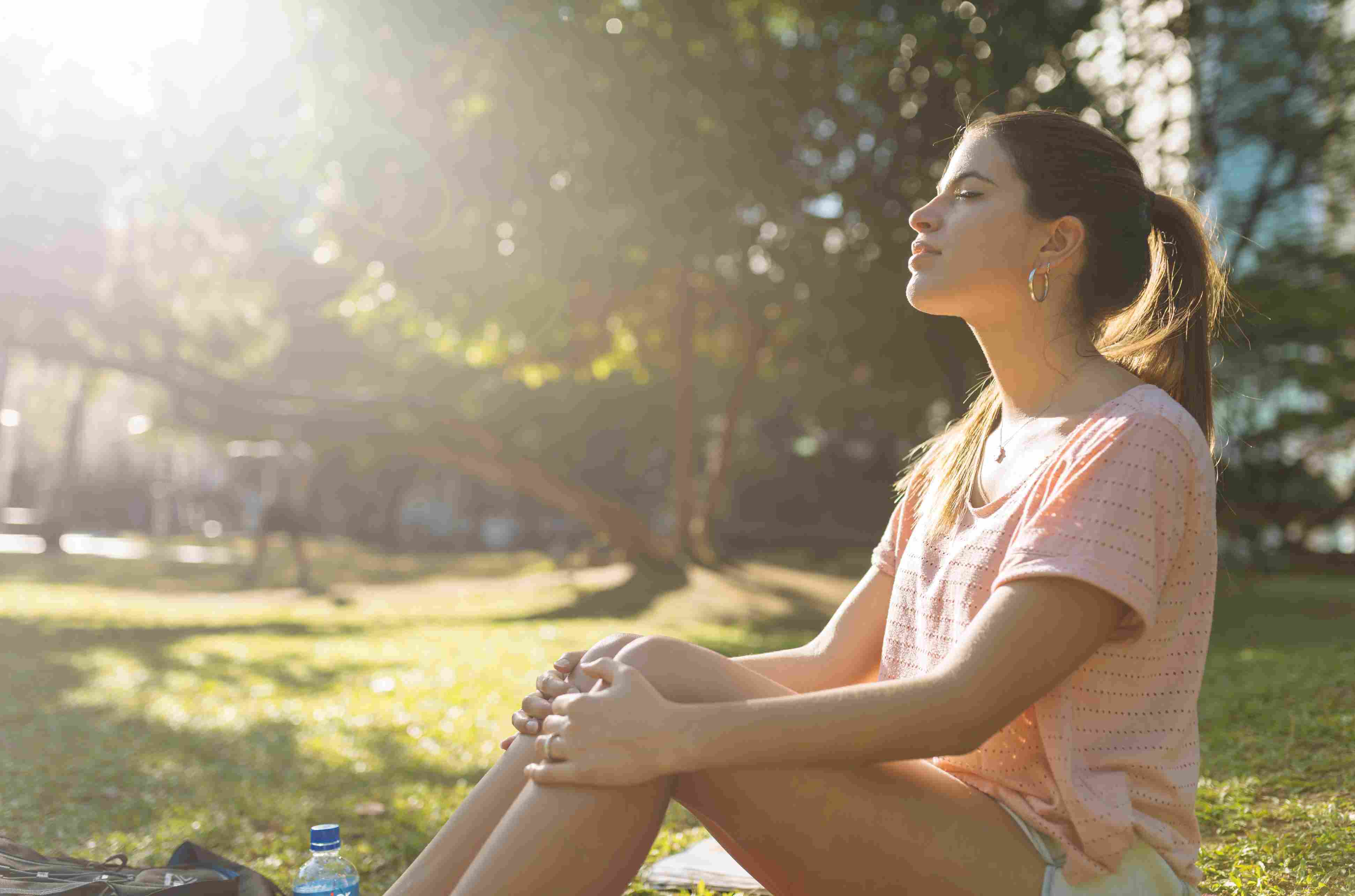 Woman relaxing in a park on a sunny day