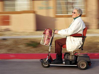 Speeding senior on motorized scooter