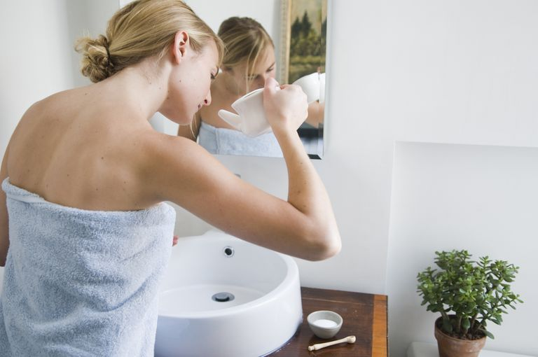 Woman Using a Neti Pot