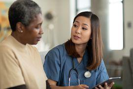 Doctor and patient discuss psoriatic arthritis