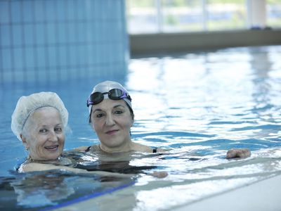 Feisty older woman swimming in a pool.