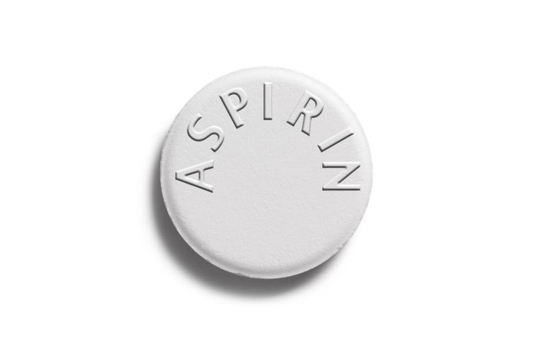 Single aspirin pill with copy space