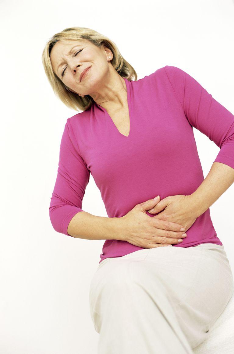 Woman holding painful abdomen