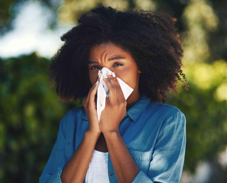 Woman suffering from seasonal allergies
