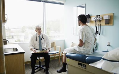 Man with doctor in exam room