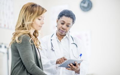 Doctor going over treatment plan with patient