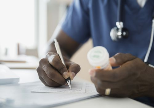 Doctor writing perscription