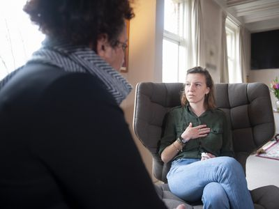 young woman talking to a counselor