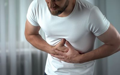 A man suffering from pancreas pain