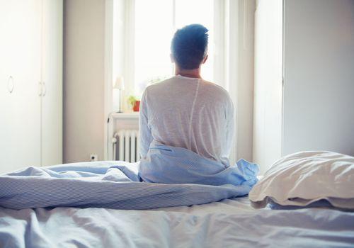 Man waking up with sunrise