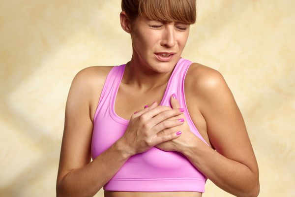 A woman experiencing breast pain with her menstrual period