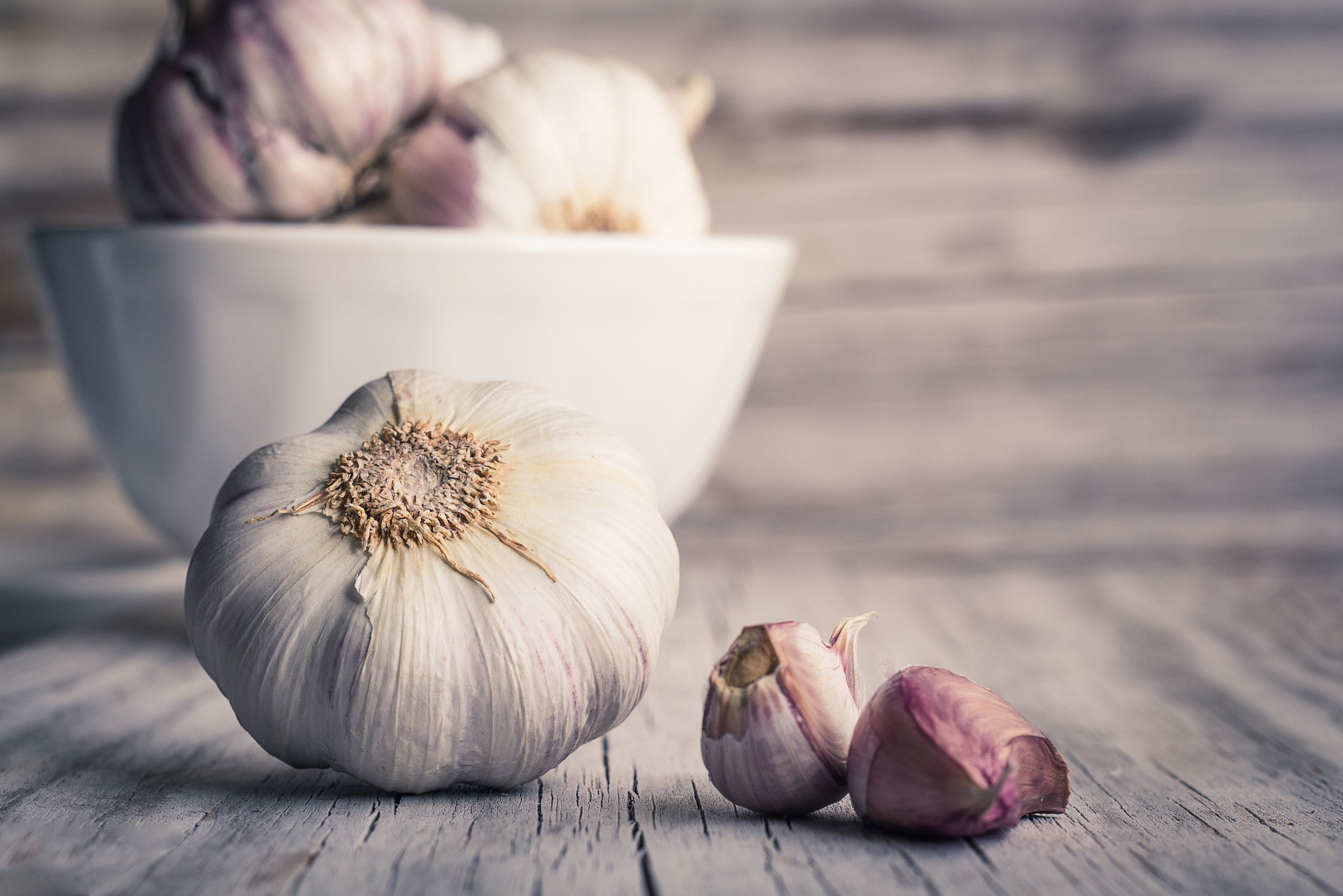 Garlic bulbs and cloves on wooden table