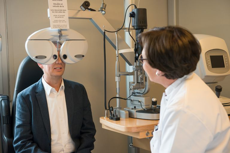 Optometrist performing an eye examination