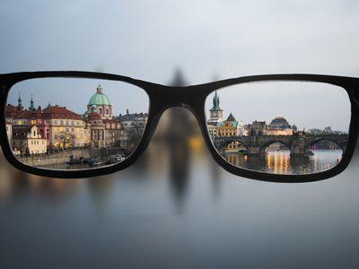 view of a city through eyeglass lenses