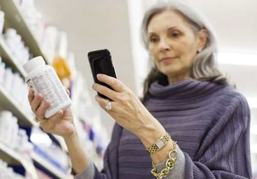 Woman on her phone in the pharmacy