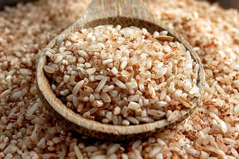 brown rice and wooden spoon