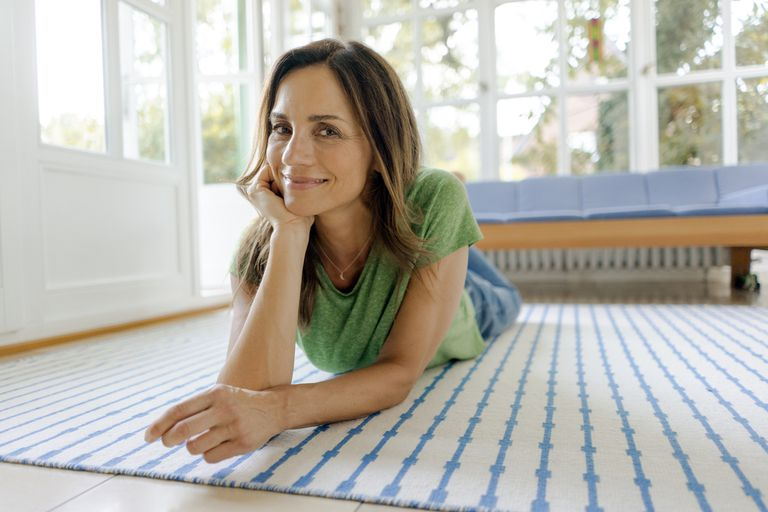 woman lying prone on the floor