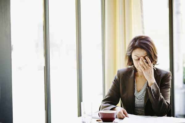 Woman at desk with headache